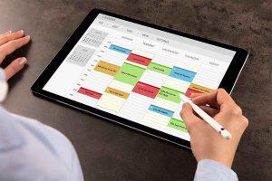 Man making schedule in calendar