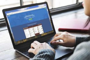 woman visited Trello site through her laptop