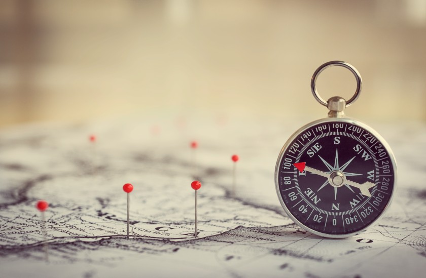 Magnetic compass on a world map