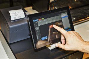 A Person Using A Cash Register