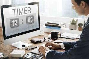 Businessman Working on Time Tracking Software