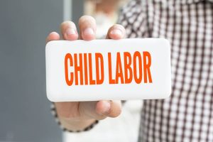 Holding a Child Labor Sign