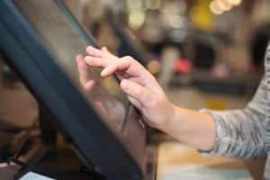 A Person Setting Up A POS System