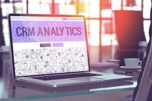 CRM Analytics on laptop screen