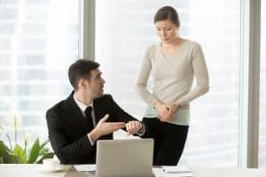 boss talking to a late employee