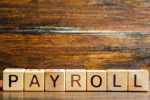 Wooden blocks with the word Payroll