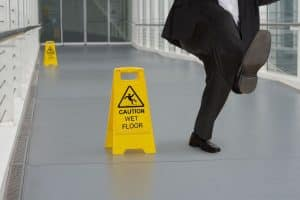 man slipping on a wet floor