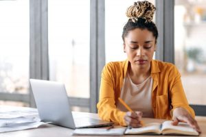 Female real estate agent studying online