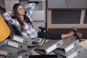 woman employee sleeping while at work