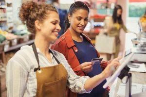 Cashier Staff and a Shopper Transacting