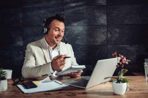 Businessman having online meeting in his office