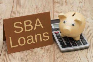 SBS Loans, piggy bank and calculator