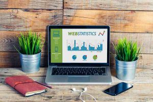 Laptop displaying website with business website statistics