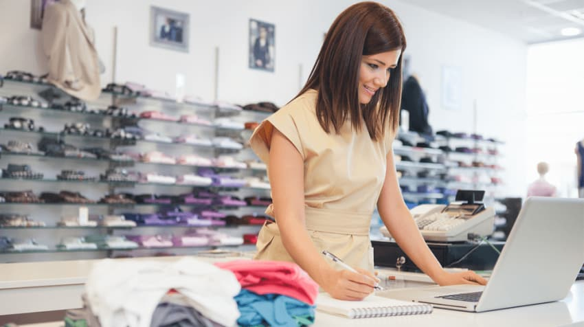 Screenshot of Smiling shop assistant working at a boutique.