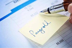 Payroll Written on a Sticky Note