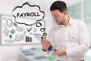 Man Looking at Payroll