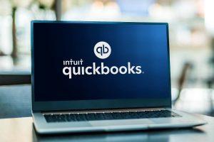 Laptop computer displaying logo of QuickBooks