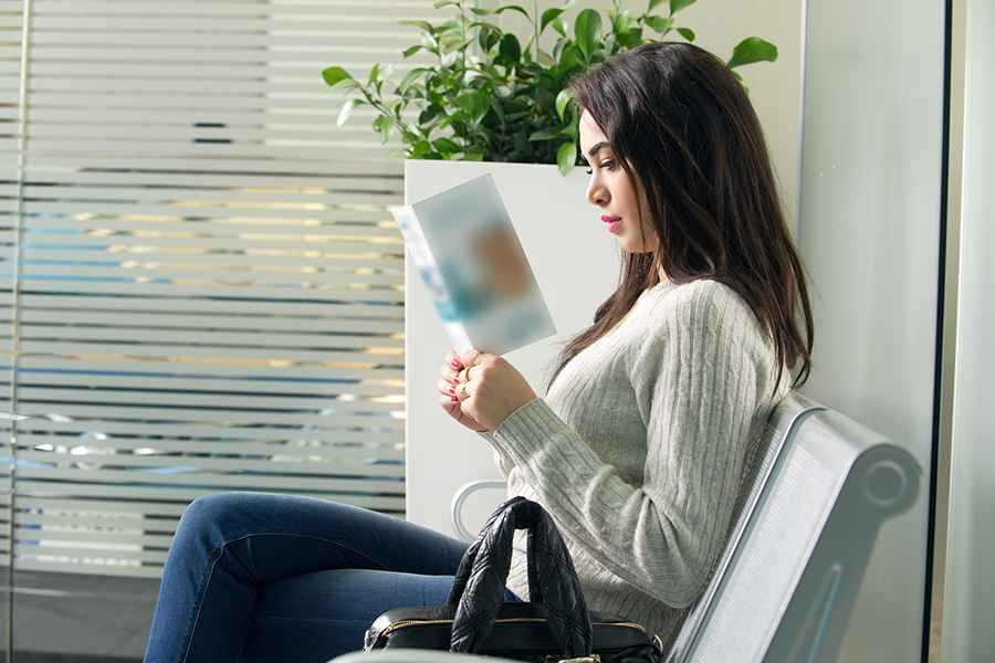Woman reading brochure
