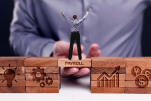 Payroll Technology Concept on Wooden Blocks