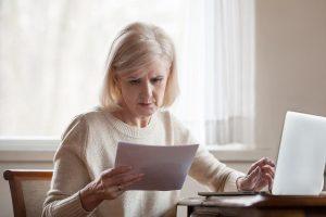 senior woman reading a press release