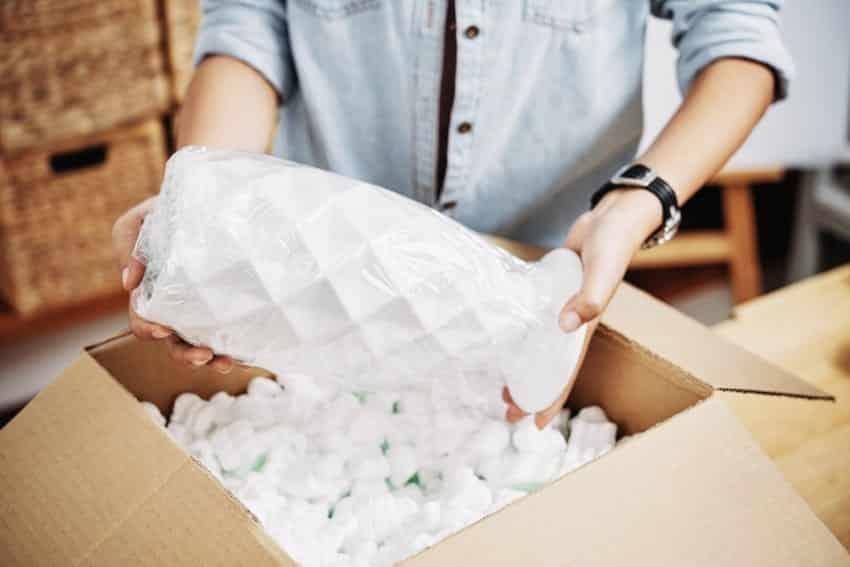 Screenshot of guy handling package