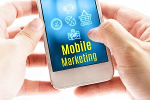 Holding A Smartphone With Mobile Marketing on Screen