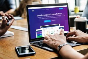 Sales Commission Tracking Software on laptop screen