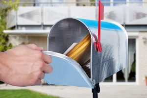 Man's hand opening the mailbox