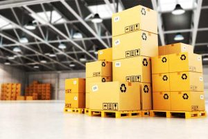 Forklift truck and pallets with cardboard boxes in storehouse office building interior