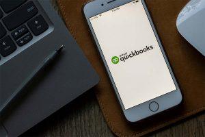 Smart phone showing Quickbooks app logo